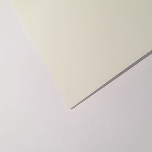 SIHL Ivory Colour Matt Paper 210gsm - shown photographed next to bright white office copier paper