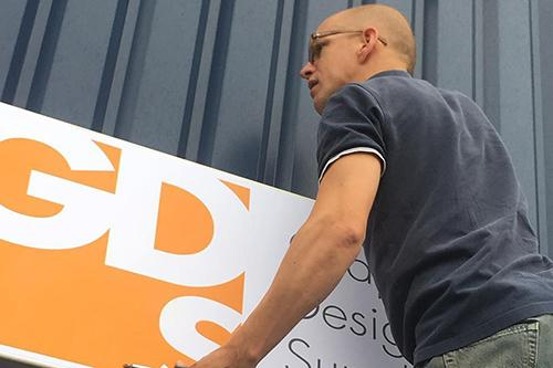 GDS outdoor banner being fitted